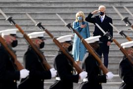 President Joe Biden and his wife Jill Biden watch a military pass in review ceremony on the East Front of the Capitol at the conclusion of the inauguration ceremonies