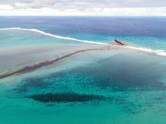 An aerial photograph taken on August 6, 2020 shows a large amount of oil near the vessel MV Wakashio, that ran aground near Blue Bay Marine Park off the coast of Mauritius