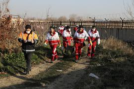 The rescue workers carry the body of a victim of a Ukrainian plane crash in Shahedshahr southwest of the capital Tehran, Iran, 8 January 2020.