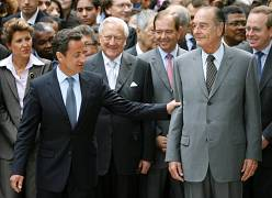 France's incumbent President Jacques Chirac (R) and newly-elected President Nicolas Sarkozy (L) attend a ceremony to pay tribute to the abolition of slavery at the Jardin du L