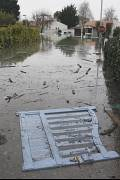 A gate floats down a flooded street of La Faute sur Mer, Monday, March 1, 2010.
