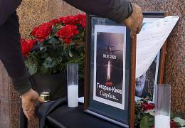 A makeshift memorial placed outside the Iranian Embassy in Kyiv, Ukraine. The words reading 'Tehran - Kyiv, we're mourning'. 8 January 2020.