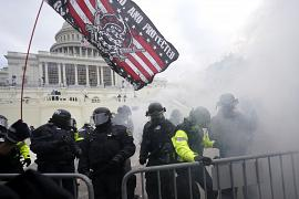 Police hold off Trump supporters who tried to break through a police barrier at the Capitol in Washington, USA. January 6, 2021
