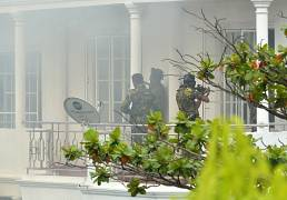Security forces outside a property where an explosion occured