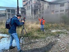 Euronews reporter Hans von der Brelie interviewing former Romanian coal miner Cătălin Cenuşă at abandoned Petrila coal mine in the Romanian Jiu Valley