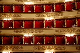 Spectators wearing masks sit prior to a show at the La Scala theater in Milan Italy.  6 July  2020.