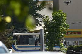 A drone flies next to a bus with passengers who have been taken hostage in the city of Lutsk. July 21, 2020