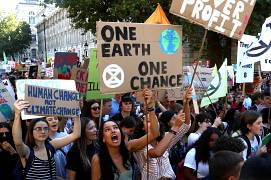 People attend a climate change demonstration in London, Britain, September 20, 2019.