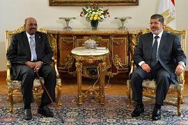 مع الرئيس السوداني المخلوع عمر حسن البشير  - أيلول 2012