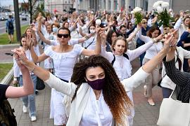 Women dressed in white clothes protest against police violence in Minsk, Belarus. August 12, 2020