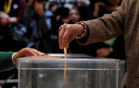 A person casts his vote during Spain's general election, outside Madrid.