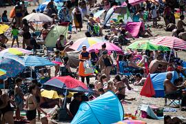 People on 'Pointe Rouge' beach as temperatures soar in Marseille, France. July 27, 2020
