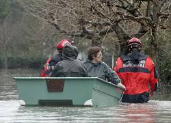 Residents of La Faute sur Mer are evacuated by firefighters as a result of a storm, Monday, March 1, 2010.