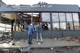 People look over a restaurant destroyed by storms.