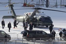 US President Donald Trump, center with red tie, waves as he arrives in Davos, Switzerland on Marine One. 21 January 2020.