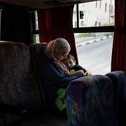 Lydia Rimawi travels with her son Majd to visit her husband in prison. She leaves home at 5am and has to take three different buses and pass through a checkpoint to reach it.