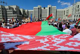 Thousands of supporters of Belarusian President Alexander Lukashenko with Belarusian state flags gather at Independence Square of Minsk, Belarus. August. 16, 2020