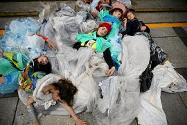 Young activists stage a performance during an environmental demonstration, part of the Global Climate Strike, in Warsaw, Poland September 20, 2019.