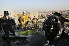 Authorities work at the scene of the Ukrainian airline plane crash near Tehran, Iran. 8 January 2020.