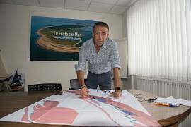 Deputy Mayor Laurent Huger shows on a map the areas where building is ban at La Faute-sur-Mer.