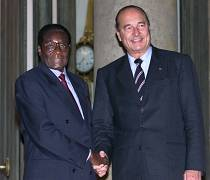 French President Jacques Chirac (R) greets Zimbabwe's President Robert Gabriel Mugabe (L) at the Elysee Palace in Paris, France October 28, 1999.