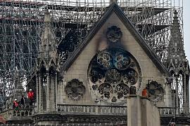 Inspectors are seen on the roof of the landmark Notre-Dame Cathedral in central Paris on April 16, 2019, the day after a fire ripped through its main roof. Paris, France