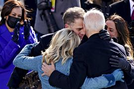 US President Joe Biden hugs his son Hunter Biden and First Lady Jill Biden after being sworn in during the 59th presidential inauguration in Washington, DC
