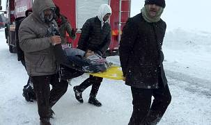 Emergency service members carry a casualty at the site of avalanche near the town of Bahcesehir, in Van province, eastern Turkey.