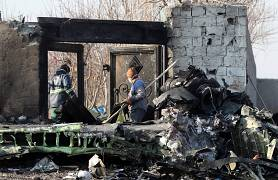 Rescue teams work amidst debris after a Ukrainian plane carrying 176 passengers crashed near Imam Khomeini airport in the Iranian capital Tehran. 8 January 2020.