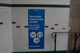 The stickers in Paris metro reminds the passengers to keep social distance, using masks and washing hands in the peak hours