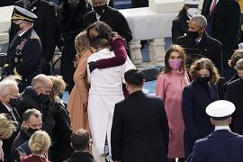 Former first lady Michelle Obama hugs members of the Biden family during the 59th Presidential Inauguration at the U.S. Capitol in Washington. January 20, 2021