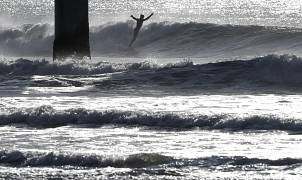 A surfer rides a winter wave at New Brighton Beach in Christchurch, New Zealand. 2 July  2020