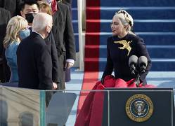 Lady Gaga talks to President-elect Joe Biden and Jill Biden after singing the National Anthem during the 59th Presidential Inauguration at the U.S. Capitol in Washington