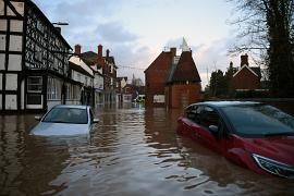 Flood water surrounds abandoned cars left in a flooded street in Tenbury Wells, after the River Teme burst its banks in western England. 16 February 2020.