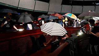 Protesters take the seats in the parliament chamber