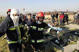 Authorities work at the scene of the Ukrainian airline plane crash in Shahedshahr, southwest of the capital Tehran, Iran. 8 January 8, 2020.