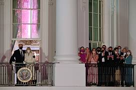 US President Joe Biden and First Lady Jill Biden appear on the Blue Room Balcony as they and family members watch fireworks from the White House in Washington