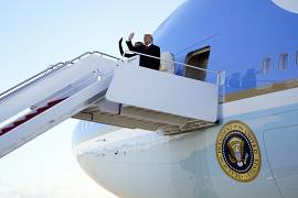 President Donald Trump and first lady Melania Trump board Air Force One at Andrews Air Force Base. January 20, 2021