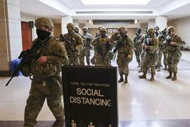 National Guard troops leave the U.S. Capitol Visitor Center after rehearsals for President-elect Joe Biden's inauguration, in Washington. January 18, 2021