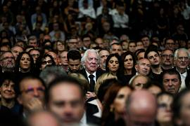 US actor Donald Sutherland (C) listens to a speech during the opening ceremony of the 11th edition of the Lumiere Film Festival in Lyon, central eastern France, on October 12,