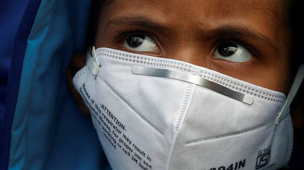 A child wears a face mask for protection from air pollution in Delhi