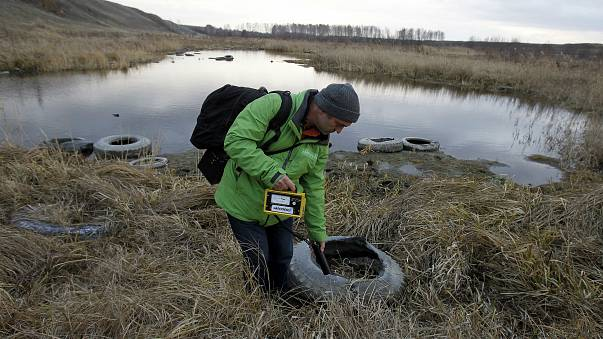 An activist takes radiation readings near Mayak nuclear complex in 2010.