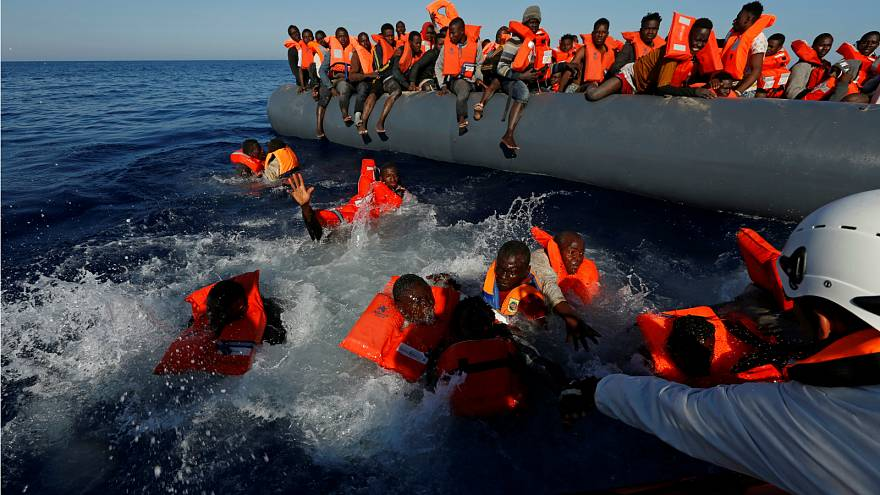 Migrants try to stay afloat during a rescue operation in the Mediterranean