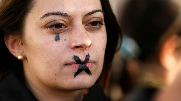A woman demonstrates against sexual violence in Marseille, France