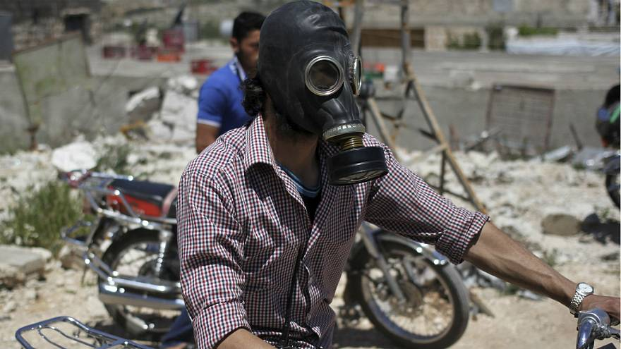 A man wears a gas mask in Idlib, Syria