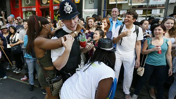 A policeman joins in celebrations at the Notting Hill Carnival in London
