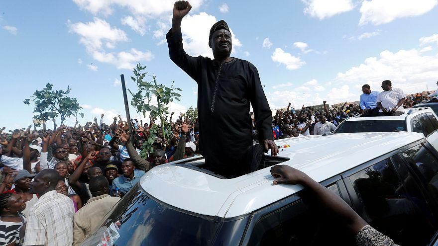 Kenyan opposition leader Raila Odinga greets supporters in Nairobi