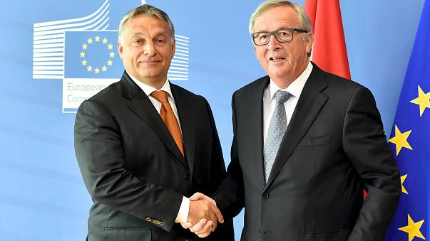 Hungary's Prime Minister Viktor Orban (L) is welcomed by European Commissio