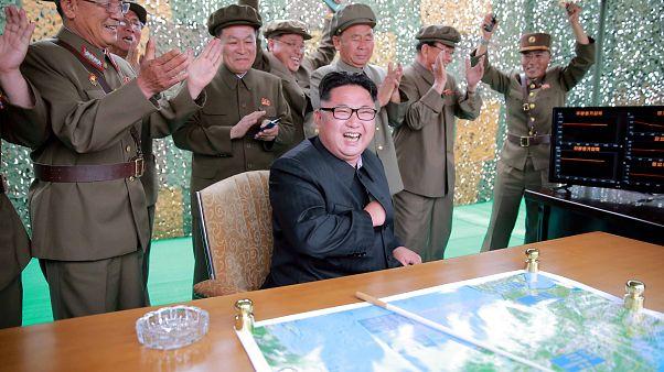 North korea leader celebrating firing new missile