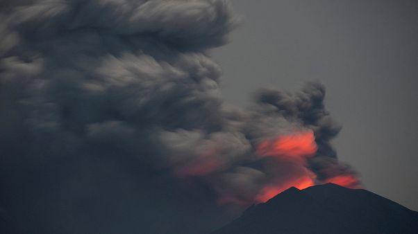 Mount Agung's mighty ash cloud hides rising molten lava